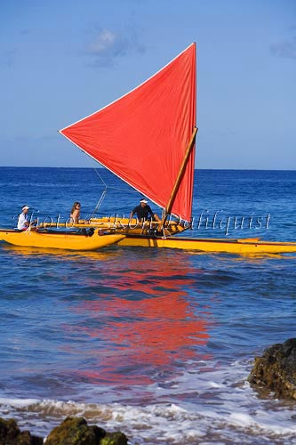 Traditional Hawaiian Sailing Canoe off Wailea Coastline, Maui, Hawaii MR Photo Stock Photo