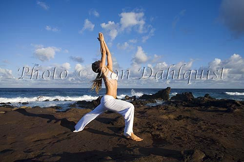 Early morning yoga on the north shore of Maui, Hawaii