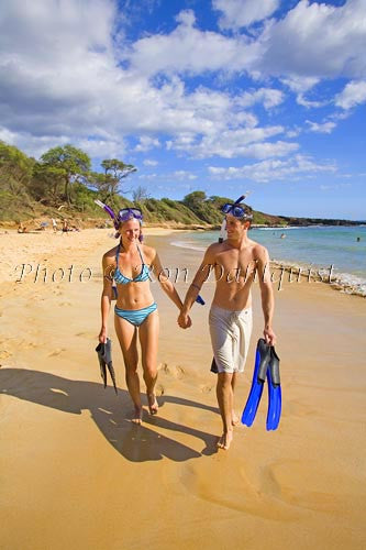 Couple walking on Little Beach after snorkeling. Makena, Maui, Hawaii MR