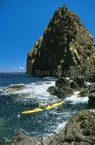 Kayaker at rocks near Kahakuloa, Maui, Hawaii