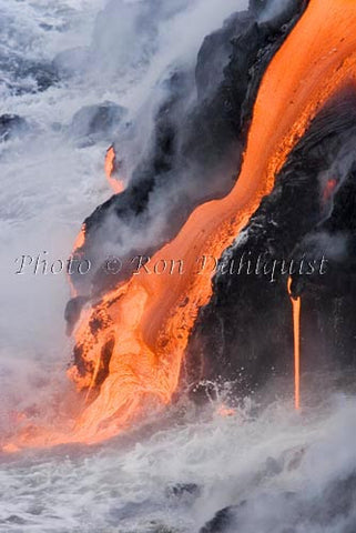 Molten pahoehoe lava from Kilauea enters the Pacific Ocean near Kalapana, Big Island of Hawaii. Picture Photo
