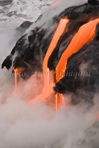 Molten pahoehoe lava from Kilauea enters the Pacific Ocean near Kalapana, Big Island of Hawaii. Picture