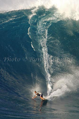 Surfer, Laird Hamilton, on a big day at Peahi, also known as Jaws, Maui, Hawaii MNR Picture Photo