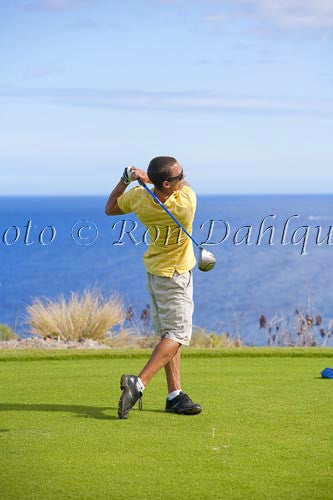 Young man hitting a tee shot at The Challenge at Manele golf course, Lanai, Hawaii