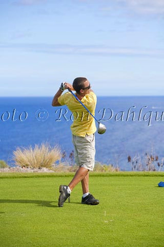 Young man hitting a tee shot at The Challenge at Manele golf course, Lanai, Hawaii - Hawaiipictures.com