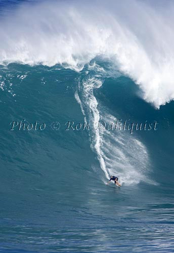 Surfer, Laird Hamilton, on a big day at Peahi, also known as Jaws, Maui, Hawaii MNR