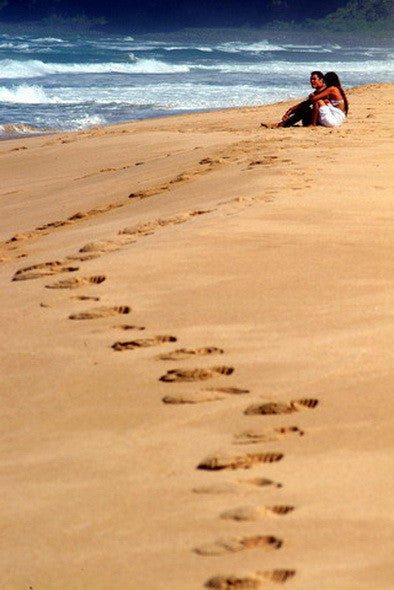 Picture Of Footsteps On Beach With Couple