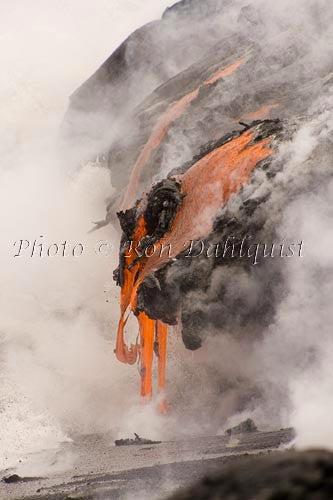 Lava from Kilauea volcano pouring into the sea. Big Island of Hawaii Photo