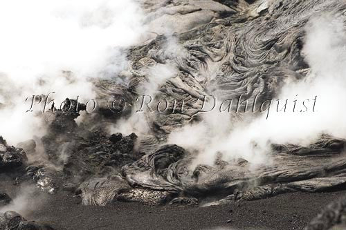 Steam rising through newly formed Pahoehoe lava, Big Island of Hawaii