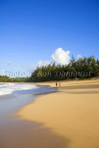 Couple walking on Baldwin Beach, north shore of Maui - Hawaiipictures.com