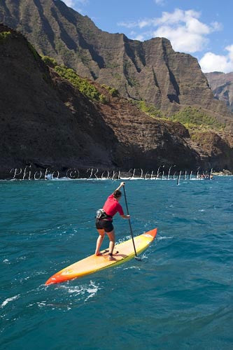 Stand-up paddling along the NaPali coastline of Kauai, Hawaii Picture Photo