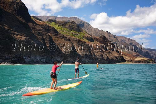 Stand-up paddling along the NaPali coastline of Kauai, Hawaii Photo