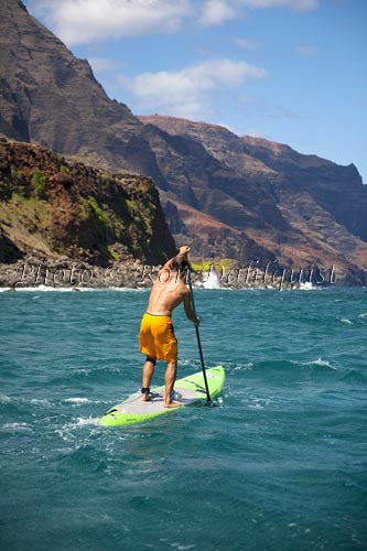Stand-up paddling along the NaPali coastline of Kauai, Hawaii Picture - Hawaiipictures.com
