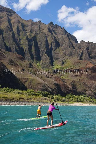 Stand-up paddling along the NaPali coastline of Kauai, Hawaii - Hawaiipictures.com