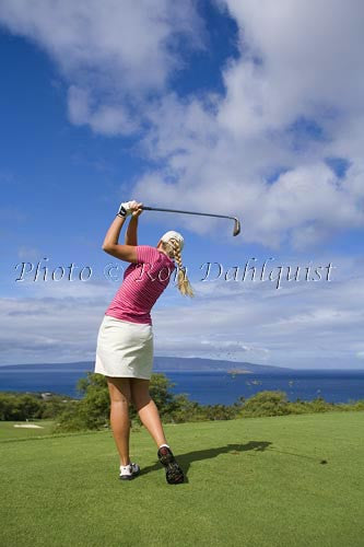 Woman golfing at Wailea Gold Golf Course, Maui, Hawaii Photo