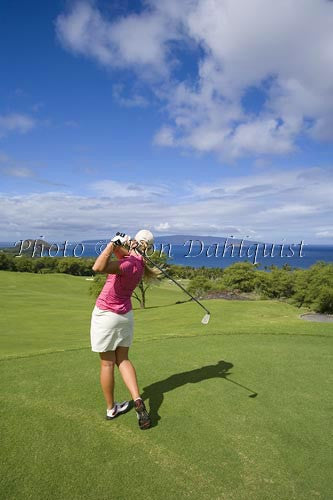 Woman golfing at Wailea Gold Golf Course, Maui, Hawaii Picture - Hawaiipictures.com
