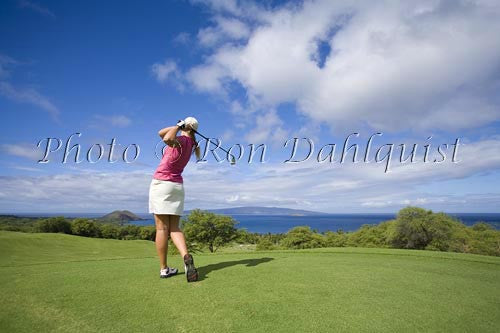 Woman golfing at Wailea Gold Golf Course, Maui, Hawaii