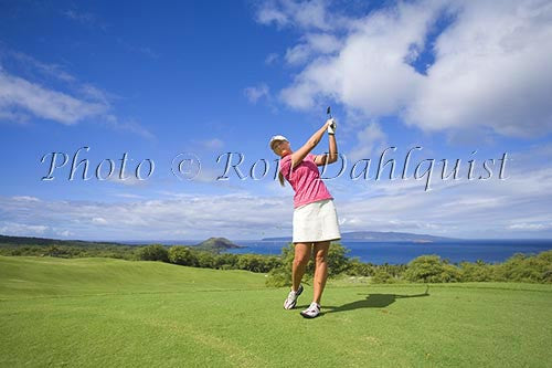 Woman playing golf at the Wailea Gold Golf Course, Wailea, Maui, Hawaii