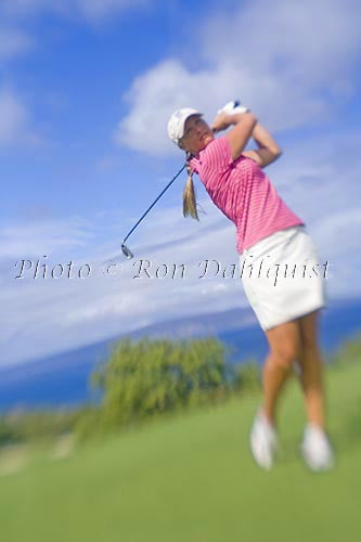 Woman playing golf at the Wailea Gold Golf Course, Wailea, Maui, Hawaii Picture