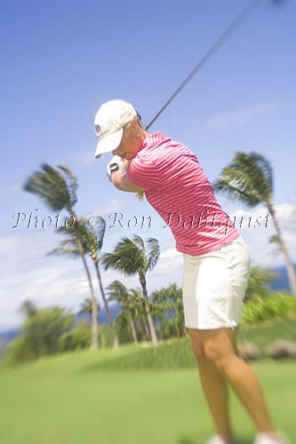Woman playing golf at the Wailea Gold Golf Course, Wailea, Maui, Hawaii Photo