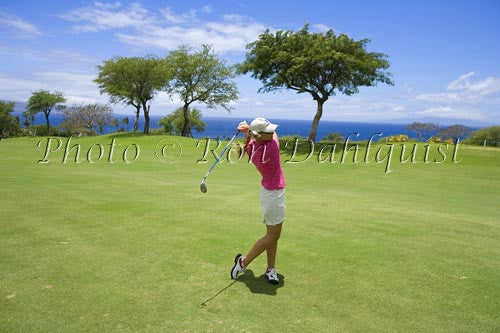 Woman golfing on the Wailea Gold Golf Course, Wailea, Maui, Hawaii