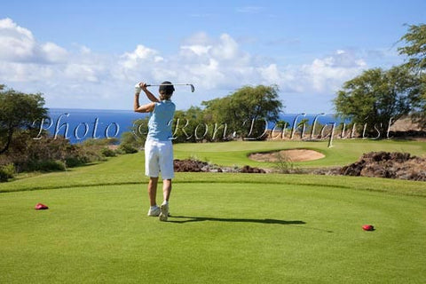 Woman golfing on The Challenge at Manele Golf Course, Lanai MR Picture Photo Stock Photo - Hawaiipictures.com