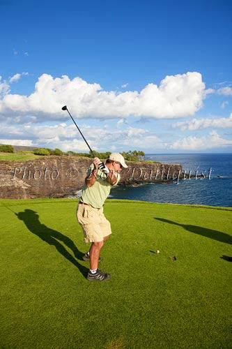 Woman golfing on The Challenge at Manele Golf Course, Lanai MR Stock Photo
