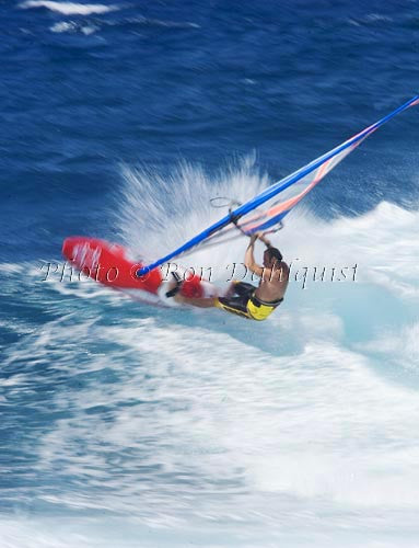 Windsurfing-Windsurfer on wave at Hookipa, Maui, Hawaii Picture Stock Photo