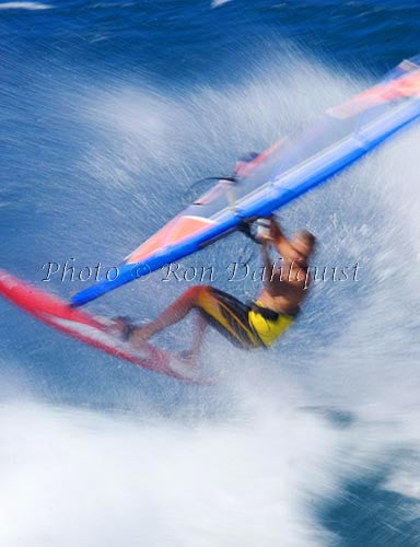 Windsurfing-Windsurfer on wave at Hookipa, Maui, Hawaii