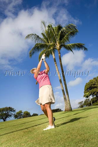 Woman golfing on Maui, Hawaii MR