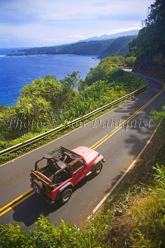 Red jeep driving the road to Hana near Hanamanu, Maui, Hawaii Picture
