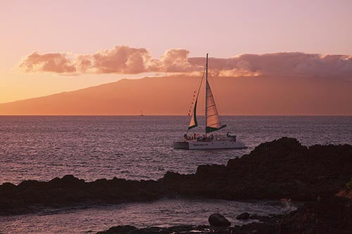 Saling at sunset in Maui, Hawaii