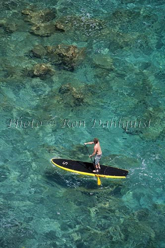 Man stand-up paddle boarding over shallow reef on Lanai, Hawaii Photo