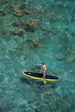 Man stand-up paddle boarding over shallow reef on Lanai, Hawaii Photo - Hawaiipictures.com