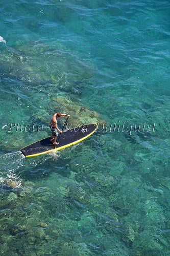 Man stand-up paddle boarding over shallow reef on Lanai, Hawaii Picture