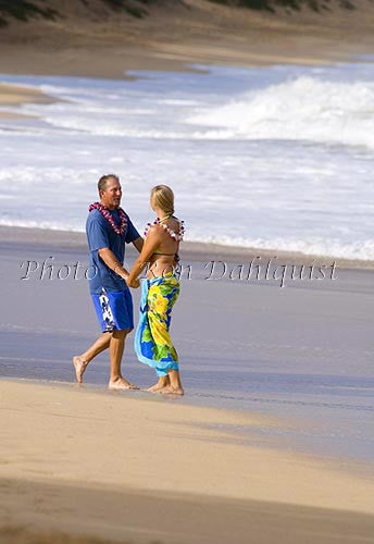 Couple walking on the beach on Maui, Hawaii