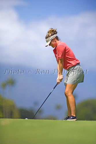 Woman golfing at Maui Country Club, Maui, Hawaii Picture