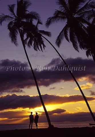 Couple viewing sunset on Molokai, Hawaii