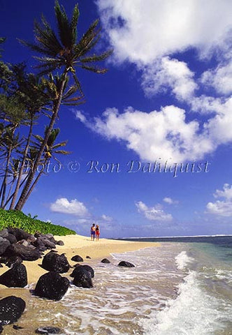 Couple on secluded beach in east Molokai, Hawaii