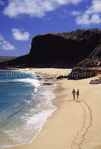Couple walking on Make Horse beach, Molokai, Hawaii