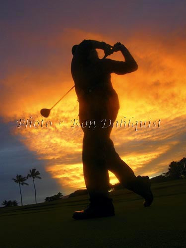 Silhouette of golfer at sunset. Maui, Hawaii