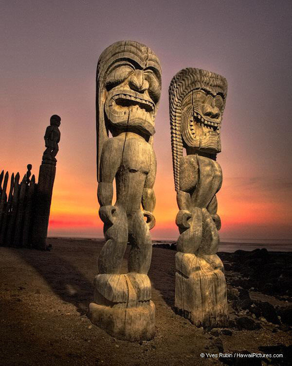 Two Tikis At Sunset
