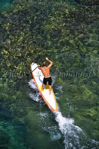 Stand-up paddle boarding on the West shore of Maui, Hawaii Photo
