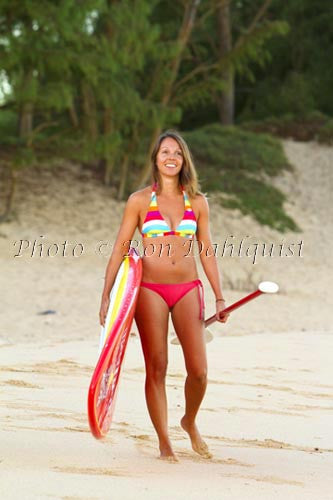 Young woman stand-up paddle boarding on Maui, Hawaii
