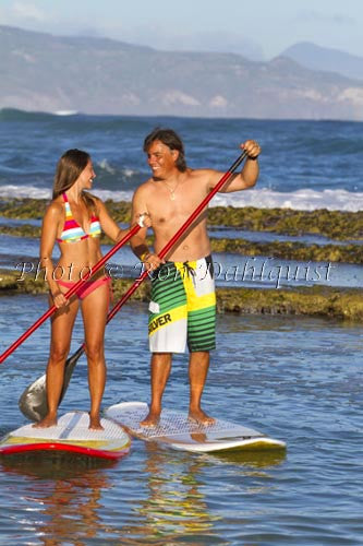 Coulple stand-up paddle boarding on Maui, Hawaii