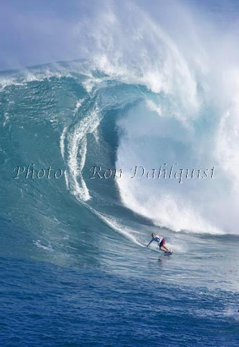 Surfer on a big day at Peahi, also known as Jaws, Maui, Hawaii MNR