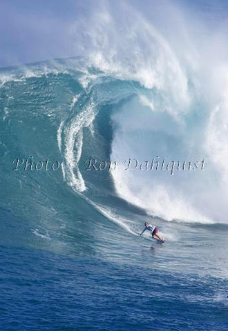 Surfer on a big day at Peahi, also known as Jaws, Maui, Hawaii MNR - Hawaiipictures.com