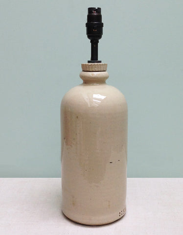 A stoneware hot water bottle lamp