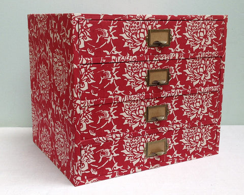 Red paper covered drawers