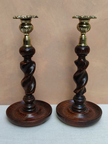A Pair Of Oak barley Candlesitcks